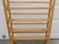 Nice natural wood CD or DVD rack that can also be use