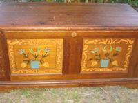 Sturdy wooden chest with flowers on the front This does