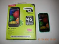 2 cell phones, slightly used Moto E on the Straight