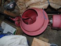 This cement mixer is brand new and it is a faded red