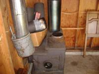 Centennial wood stove.  Approx. 25x34.  Includes Condar