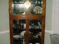 This is a gorgeous CENTURY Curio cabinet.