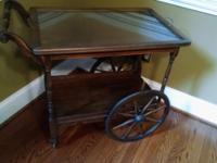 Beautiful Mahogany tea cart bar cart that has been in