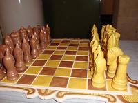 "Ceramic chess set. King stands 4"" and an 1/8"" tall. Set"