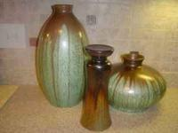 "3 pieces of coordinating pottery. The tallest is 17"","