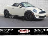 This 2015 Mini Cooper Roadster S is Pepper White with