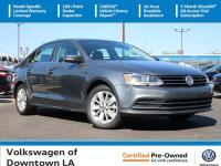Certified. Platinum Gray Metallic 2016 Volkswagen Jetta