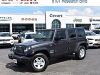 This Jeep Wrangler is conveniently located at Covert