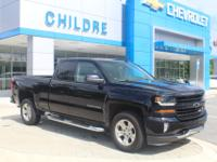 This Silverado LT has low miles and looks brand new.