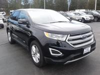 This 2018 Ford Edge SEL has a 2.0L 4 cyls. Standard