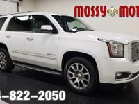 This outstanding example of a 2015 GMC Yukon Denali is