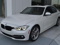 This 2016 BMW 340i is Mineral White Metallic with a