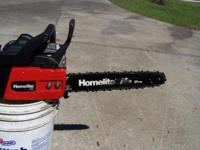 FORE SALE IS A BEARLY USED HOMELITE 14 INCH CHAIN SAW