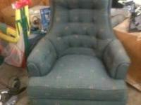 Nice chair. Great condition. greenish blue in color.