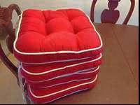 4 cute chair cushions for sale. its for counter bar