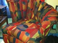 This modern barrel style chair is covered in a fun,