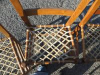4 wood and rawhide chairs for sale.