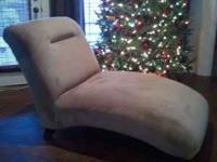 Tan Chaise lounger. Very comfortable. Very good