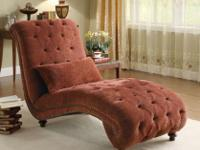 . The deep button-tufted surface and nailhead trim
