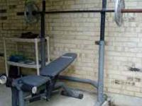 Barely used weight bench complete with bars and
