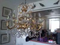 12 Lights, Crystal and Brass Tiered Chandelier. $150,