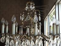 Very nice brass and crystal chandelier. Ten light bulbs