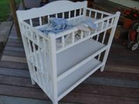 Changing table, contains 2 shelves, in good condition