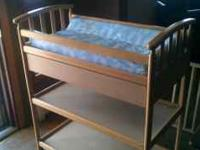 Changing table oak color,with pad, has drawer. good