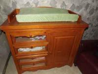 4 drawers and one cabinet. comes with changing pad and
