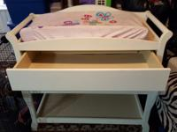 White Changing Table. Comes with changing pad and pad