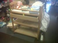 We have a brown wooden changing table and a light wood