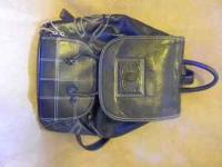 I have a black channel backpack style purse for sale.
