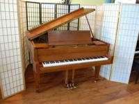This walnut Charles Stieff Grand piano has been