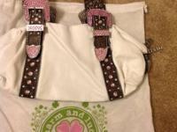 This is a carefully made use of white leather bag with