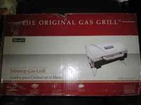 I am selling my brand new Charmglow tabletop gas grill.