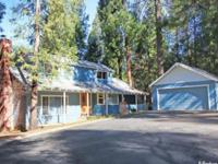 Charming three bedroom/two bath home nestled in the