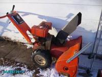 A Gilson 8hp 2-stage snow blower runs and works well