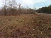 Over 5 acres of land, paved road frontage, mostly