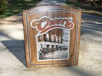 Used dart board in cheers themed cabinet. Comes with