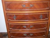Very nice, very old cherry dresser. Brand is Courtney