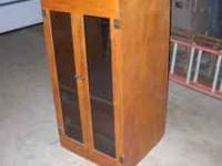 Nice cherry cabinet with glass doors. Used for