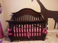 Selling our chery crib for 280.00 pick up only Comes
