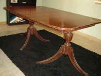 Older cherry wood dining room table. Table only, not