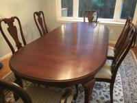Cherry dining room table in excellent condition. Table