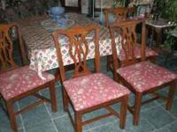 A good set of four Bassett dining room chairs. Solid