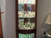 Beautiful lighted corner curio cabinet. Has 5 glass