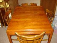 Nice starter home cherry oak table with 4 chairs.
