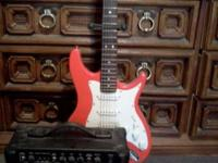 Cherry red guitar for sale. Barely used. Missing one