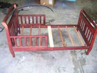 cherry color sleigh toddler bed. The bed does have a