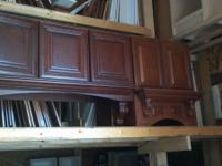 2 Cherry stained stove hoods with decorative corbels